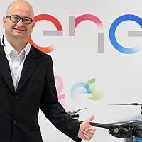 Enel's Ernesto Ciorra, Head of Innovability, with Percepto's drone (Courtesy)