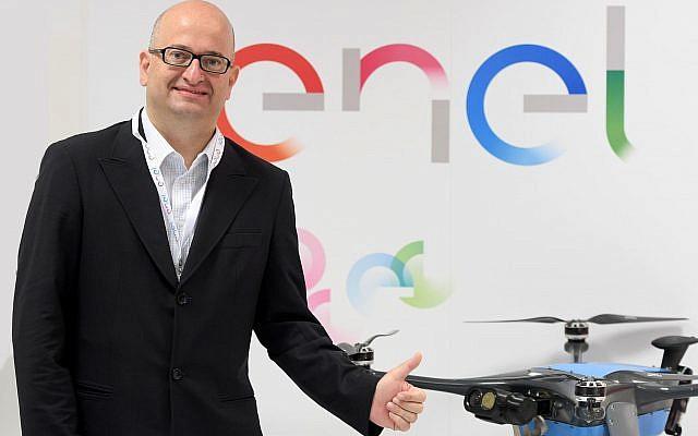 Enel's Ernesto Ciorra, Head of Innovability, with Percepto's drone (Courtesy)