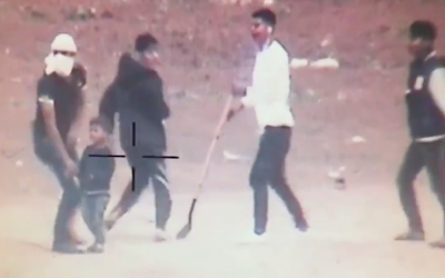 A small Gazan child next to youths during violent protests at the Gaza border, in footage released by the IDF on May 5, 2018 (screenshot)
