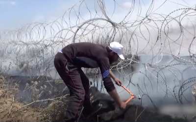 A Palestinian man takes wire cutters to a border fence in footage released by the IDF from May 14 violence at the border (Israel Defense Forces)