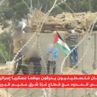 A group of Palestinian men set fire to an Israeli military sniper position near the Gaza security fence, on May 22, 2018. (Screen capture: Al-Jazeera)