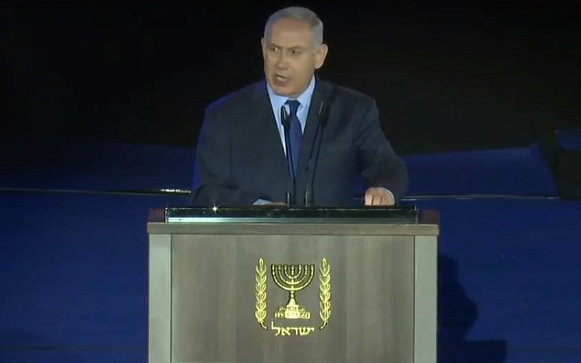 Prime Minister Benjamin Netanyahu speaks at a ceremony marking the 70th anniversary of the Israel Defense Forces at the Armored Corps memorial at Latrun