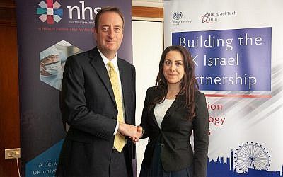 British Ambassador to Israel, David Quarrey, left, and  Head of Corporate Affairs for the NHSA Suzanne Ali-Hassan sign the MOU during  MIXiii Biomed 2018 in Tel Aviv; May 16, 2018 ( MIXiii Biomed 2018)