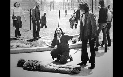 John Filo's Pulitzer Prize–winning photograph of Mary Ann Vecchio, a 14-year-old runaway, kneeling over the body of Jeffrey Miller minutes after he was fatally shot by the Ohio National Guard at Kent State University on May 4, 1970. (Via JTA)