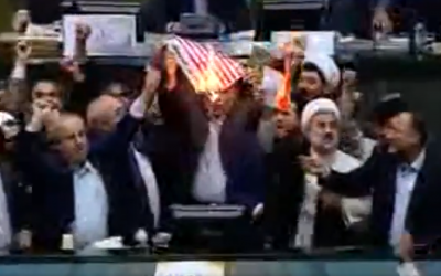 Iranian lawmakers burn paper US flag in parliament on May 9, 2018, after US President Donald Trump withdraws from nuclear deal. (Screen capture: Twitter)