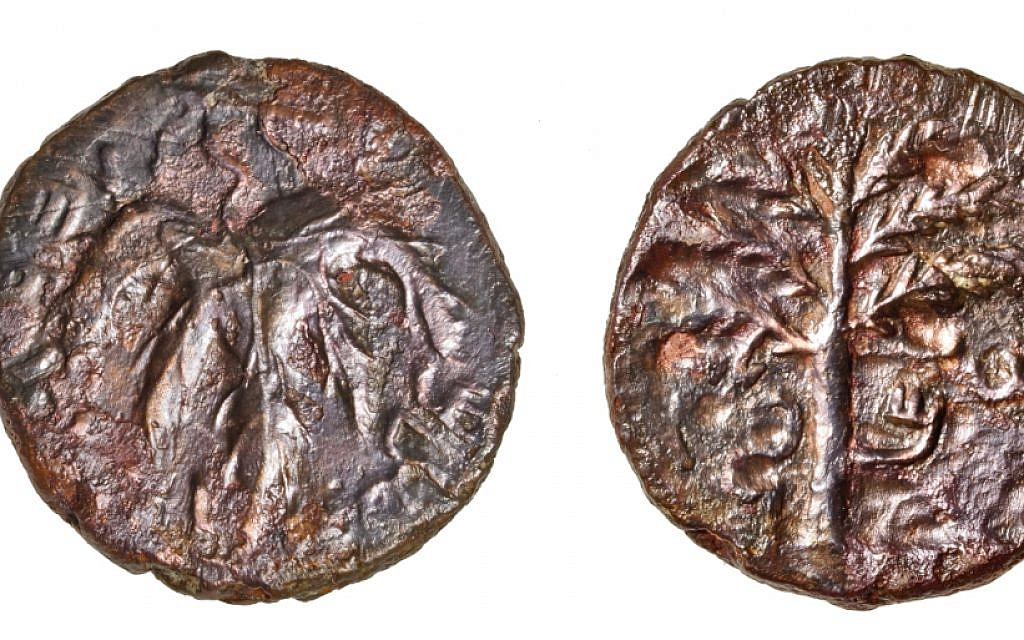A bronze coin that was found in a limestone cave near Modiin, that dates to the final years of the 132 CE Bar Kochba revolt against the Roman Empire. (COGAT spokesman)