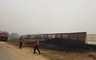 Fire fighters work to control fire near the southern moshav of GIlat. (Fire and Rescue Services)
