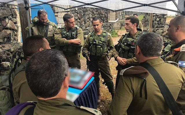 IDF chief Gadi Eisenkot (brown beret) meets with senior officers from the Northern Command amid concerns of potential Iranian missile strike against northern Israel on May 9, 2018. (Israel Defense Forces)