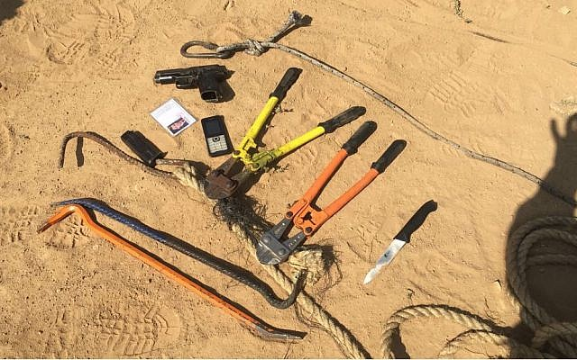 A handgun, knife, crowbars and wire cutters found in possession of eight suspected Hamas terrorists who the army says opened fire at Israeli troops in the northern Gaza Strip on May 14, 2018. (Israel Defense Forces)