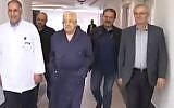 Palestinian Authority Chairman Mahmoud Abbas (2nd L) seen walking in hospital on May21 2018 (Screencapture/twitter)