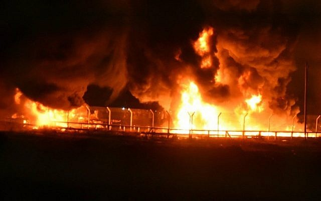 Gas pipes on fire at the Kerem Shalom goods crossing between Israel and the Gaza Strip, May 11, 2018. (Israel Defense Forces)