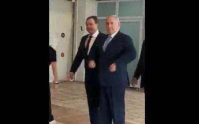 Prime Minister Benjamin Netanyahu does a chicken dance on his way to a cabinet meeting on May 13, 2018, in tribute to Netta Barzilai's winning Eurovision song, 'Toy.' (Screen capture: Twitter)