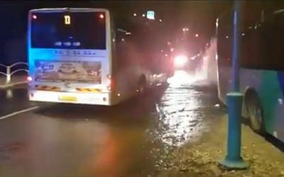 A bus in Afula that crashed into a fire hydrant after the driver was stabbed. (Screen capture/MDA)