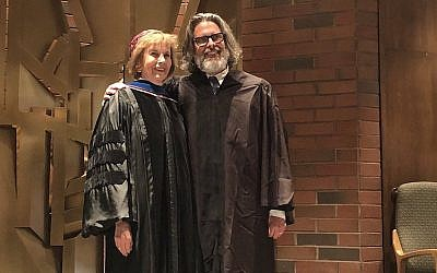 Novelist Michael Chabon, shown with his sponsor, Tamara Cohn Eskenazi, received an honorary doctorate and gave an address at the Hebrew Union College-Jewish Institute of Religion commencement ceremonies in Los Angeles, May 14, 2018. (Hebrew Union College/Twitter)