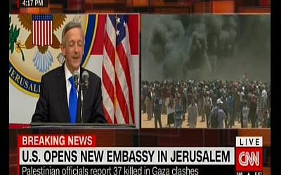 CNN shows the US embassy opening in Jerusalem on a split screen with violence on the Gaza border, May 14, 2018 (Screenshot)