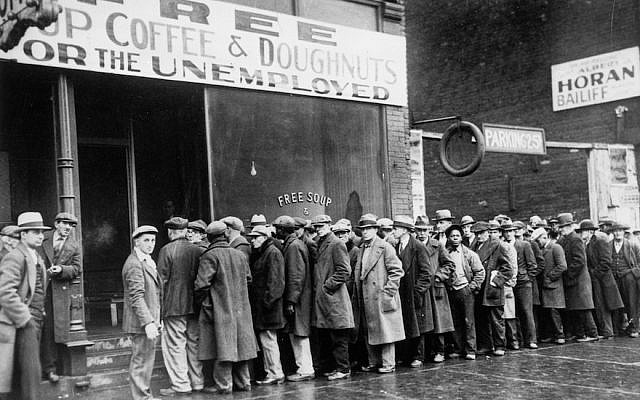 Unemployed men queued outside a Depression-era soup kitchen opened in Chicago by the mobster Al Capone in 1931. Economic uncertainty fueled Americans' anxieties about taking in large numbers of refugees from Europe. (National Archives at College Park-Still Pictures via JTA)