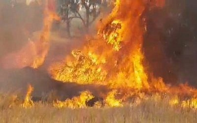 A fire caused by incendiary kites from Gaza burns near Kibbutz Kissufim on May 25, 2018. (Screen capture: Twitter)