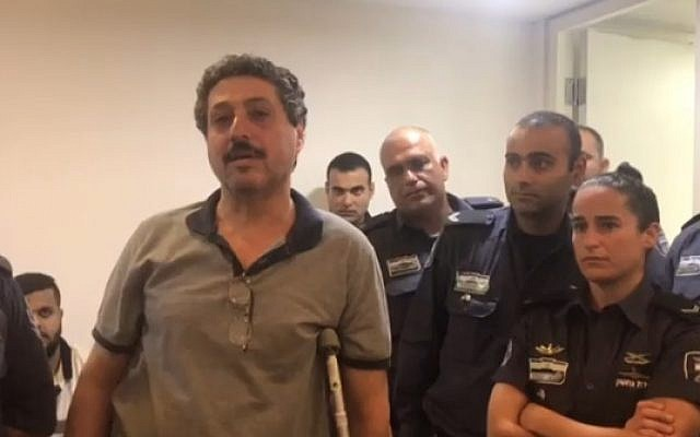 Arab-Israeli NGO worker Jafar Farah, who alleges a police officer broke his knee after he was arrested, in court on May 20 (Hadashot screenshot)