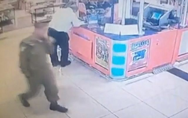 Screen capture from video of an IDF soldier, suspected of stealing weapons from his base to sell on the black market, seen as he walks through the Beersheba bus station with the some of the items in a bag (not seen). (Mako)