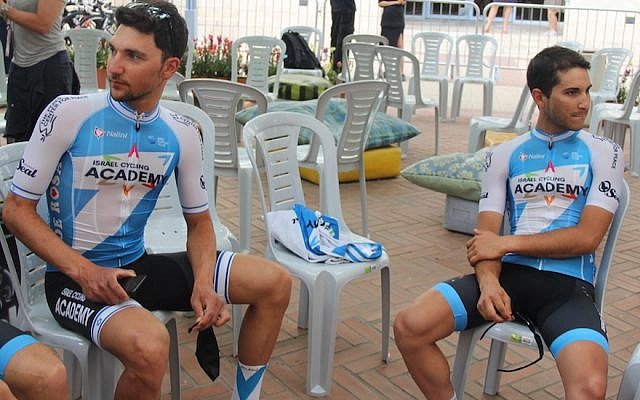 Guy Sagiv, left, and Guy Niv relaxing before the opening ceremonies of the Giro d'Italia in Jerusalem, May 3, 2018. (Ben Sales/JTA)