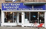 A photo taken on December 7, 2017, shows the damaged storefront of kosher Jewish restaurant HaCarmel in Amsterdam. (GINOPRESS B.V./AFP/Getty Images)