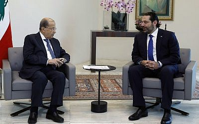 Lebanese President Michel Aoun, left, meets with Prime Minister Saad Hariri at the Presidential Palace in Baabda, east of Beirut, Lebanon, May 24, 2018. (Dalati Nohra/Lebanese Government via AP)