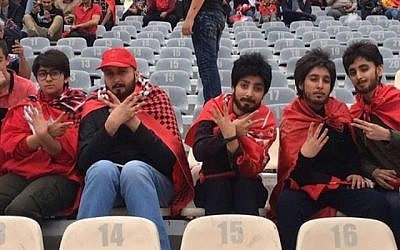 Female soccer fans in Iran who dressed up as men to sneak into a men-only soccer game in Tehran on April 27, 2018. (screen capture: YouTube)