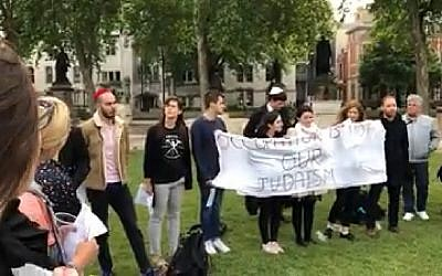 A group of Jews gather in Parliament Square, London, to recite kaddish for 62 Palestinians killed in Gaza, on May 16, 2018. (Screen capture: Facebook)