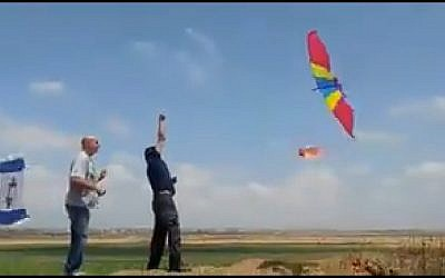 Israelis try to launch a burning kite over the border to Gaza, May 11, 2018. (Screen capture: Twitter)