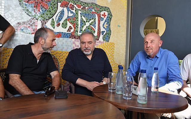 Defense Minister Avigdor Liberman (C) meets with Golan Regional Council head Eli Malka (L) and Katrzin Regional Council head Dmitry Apartzev (R) during a tour of the Golan Heights town of Katzrin on may 11, 2018. (Ariel Hermoni/Defense Ministry)
