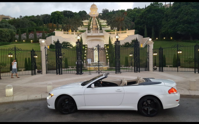 "Screenshot from the Facebook page of ""Richvei Hashalom"" a luxury car dealership in Haifa, with a car against the backdrop of the Baha'i temple in Haifa. (Facebook)."