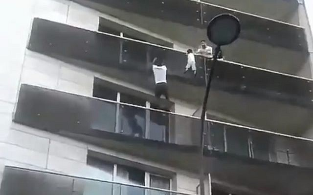 Mamoudou Gassama scales a Paris building to save a child, May 2018 (YouTube screenshot)