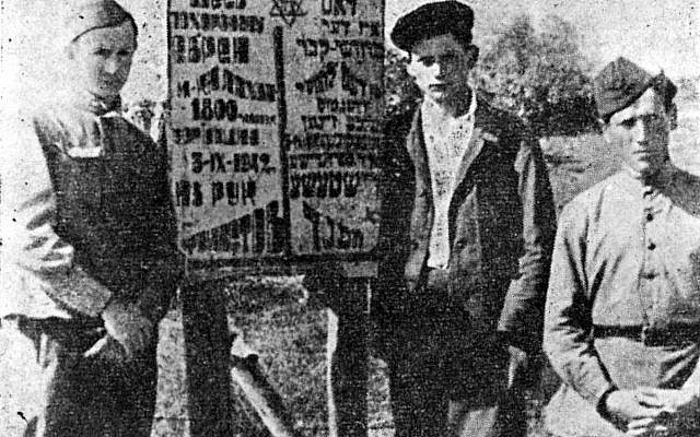 Jewish Red Army soldiers and a local survivor near the mass grave of Lachwa Jews, 1944