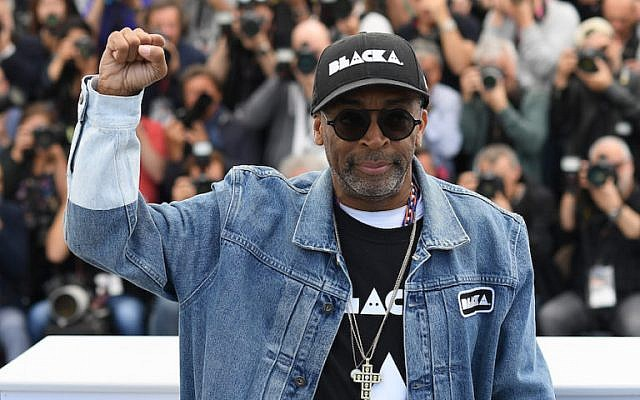 Director Spike Lee holds up a fist as he attends the photocall for 'BlacKkKlansman' during the 71st annual Cannes Film Festival at Palais des Festivals on May 15, 2018 in Cannes, France.  (Pascal Le Segretain/Getty Images via JTA)