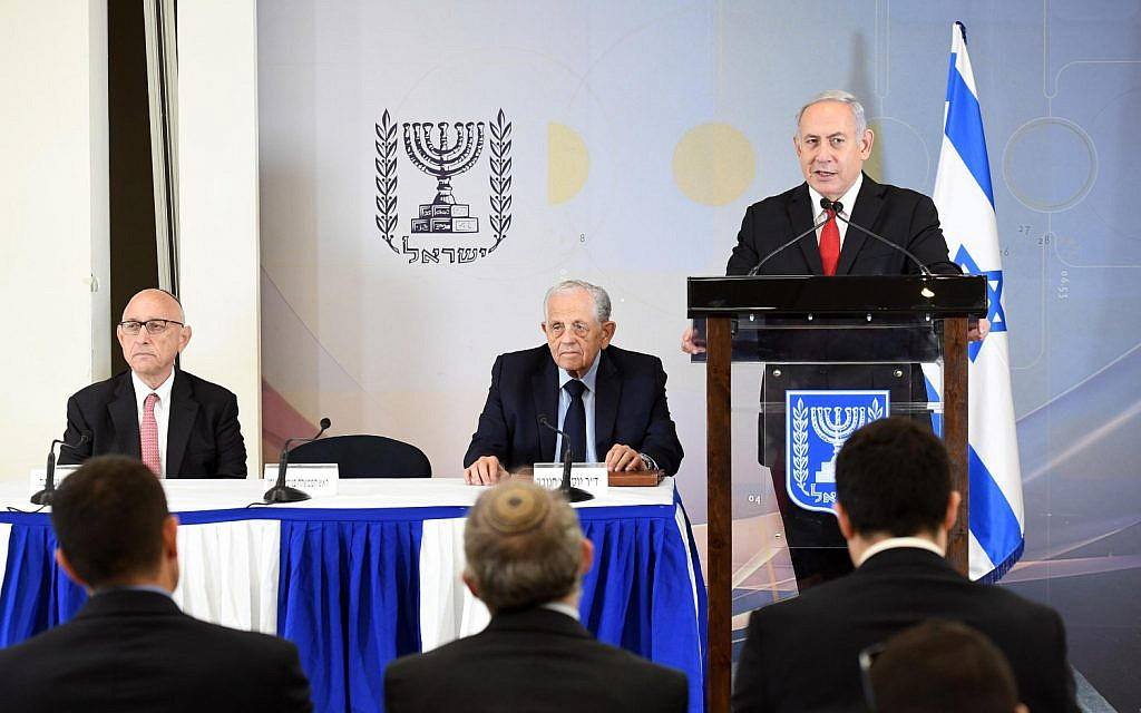 Benjamin Netanyahu, left, delivering a statement in Tel Aviv on June 27, 2018 regarding Poland's amended Holocaust law. (Haim Zach/PMO)