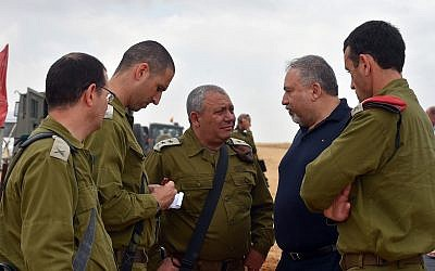 Illustrative: Defense Minister Avigdor Liberman, center-right, meets with senior officers in the IDF Southern Command, including IDF chief Gadi Eisenkot, center, and Maj. Gen. Herzl Halevi, right, on June 12, 2018. (Ariel Hermoni/Defense Ministry)