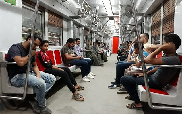People ride a train at a metro station in the Egyptian capital, Cairo, on May 28, 2018. (KHALED DESOUKI/AFP)