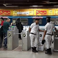 Egyptian police stand guard at a metro station in the Egyptian capital, Cairo, on May 28, 2018. (KHALED DESOUKI/AFP)