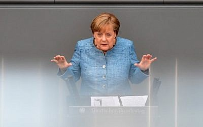 German Chancellor Angela Merkel gives a speech on her government's budget policy at the Bundestag (lower house of parliament) in Berlin, May 16, 2018. (AFP PHOTO / Tobias SCHWARZ)