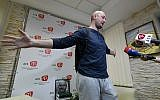 Anti-Kremlin journalist Arkady Babchenko speaks as he stands in front of a portrait of him that his colleagues displayed in his memory in the offices of his workplace, the ATR TV channel, on May 31, 2018 in Kiev. (AFP/Genya SAVILOV)