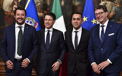 (From L) Italy's Newly appointed Prime Minister Giuseppe Conte, Italy's Interior Minister and deputy Prime Minister Matteo Salvini, Italy's Labor and Industry Minister and deputy PM Luigi Di Maio and Italy's Undersecretary for Prime Minister Giancarlo Giorgetti pose for a photograph after the bell ceremony, signifying the start of the first cabinet meeting, at Chigi Palace in Rome on June 1, 2018. (AFP PHOTO / Andreas SOLARO)