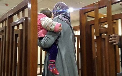 This file photo taken on February 19, 2018, shows French Jihadist Melina Boughedir carrying her son as she arrives to court in the Iraqi capital Baghdad. (AFP PHOTO / STRINGER)