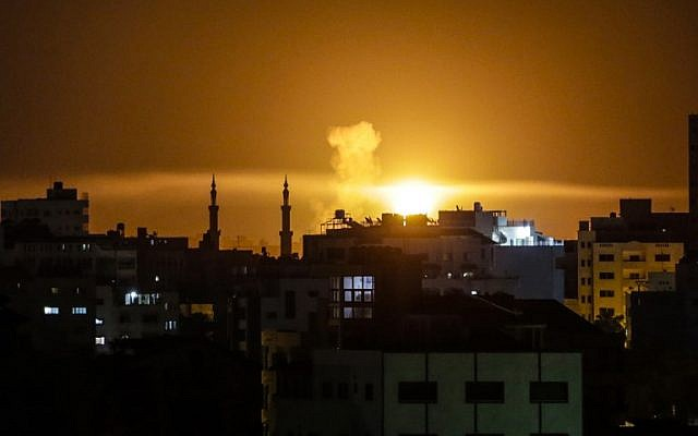 An explosion is seen in Gaza City after an airstrike by Israeli forces in response to a rocket attack earlier in the evening on June 2, 2018. (AFP PHOTO/Mahmud Hams)