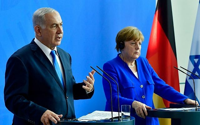 German Chancellor Angela Merkel and Israeli Prime Minister Benjamin Netanyahu address a press conference after a meeting at the Chancellery in Berlin on June 4, 2018. (AFP PHOTO / Tobias SCHWARZ)