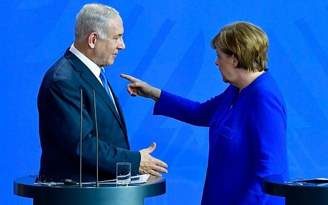 German Chancellor Angela Merkel (right) and Prime Minister Benjamin Netanyahu at a press conference after a meeting at the Chancellery in Berlin on June 4, 2018. (Tobias SCHWARZ / AFP)