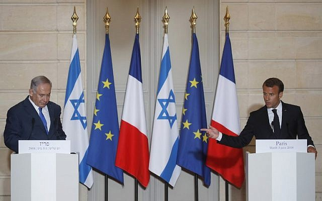 French President Emmanuel Macron, right, speaks as Prime Minister Benjamin Netanyahu listens during a joint press conference after their meeting at the Elysee Palace in Paris, on June 5, 2018. (PHILIPPE WOJAZER/AFP)