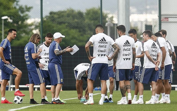 e8423ba2e Argentina's forward Lionel Messi (3L) attends a training session with  teammates in Sant Joan