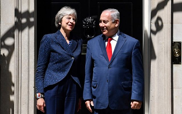 British Prime Minister Theresa May, left, greets Prime Minister Benjamin Netanyahu outside 10 Downing Street in London on June 6, 2018. (AFP PHOTO / Ben STANSALL)