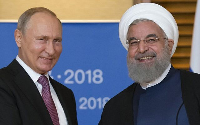Russian President Vladimir Putin, left, meets with Iranian President Hassan Rouhani on the sidelines of the Shanghai Cooperation Organisation (SCO) Summit in Qingdao on June 9, 2018. (Alexander Zemlianichenko/AFP)
