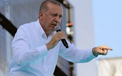 The President of Turkey Recep Tayyip Erdogan points his finger as he addresses the crowd during an election rally of ruling Justice and Development (AK) Party at 19 Mayis Stadium in Ankara, on June 9, 2018. (AFP/ ADEM ALTAN)